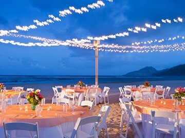 evening outdoor wedding reception area on the beach